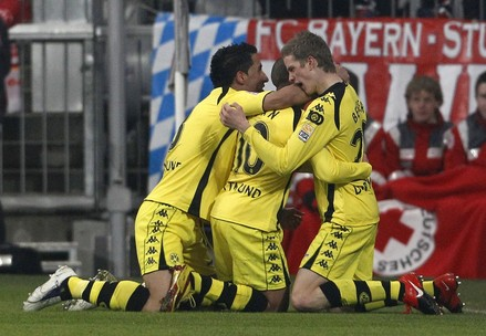 Borussia Dortmund's Barrios, Zidan and Bender celebrate goal against Bayern Munich during German Bundesliga soccer match in Munich