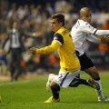Real Sociedad's Griezmann and Valencia's Feghouli fight for the ball during their Spanish first division soccer match in Valencia