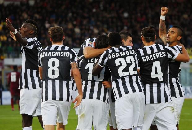 PIña de jugadores juventinos celebrando un gol(Foto: AP Photo/ Francesco Speranza )